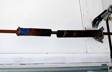 Garage door spring replacement minnesota, fix garage door spring minnesota, how to fix garage door spring Minnesota